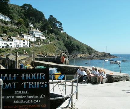 Day trippers waiting for their sightseeing tour of the coast at Polperro